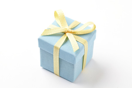 blue gift box on white background.  blue Gift box with yellow ribbon. Banco de Imagens