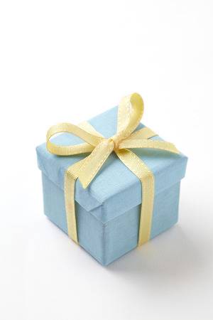 blue gift box on white background.  blue Gift box with yellow ribbon.