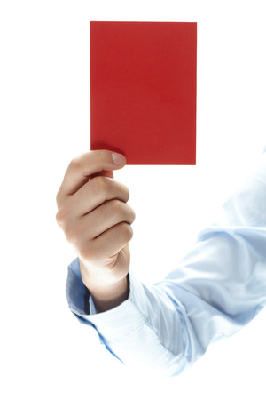 hand of showing red card on white background