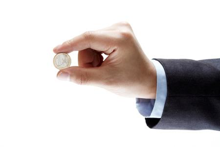 A hand holding an euro coin