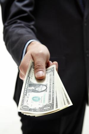 A hand holding an money