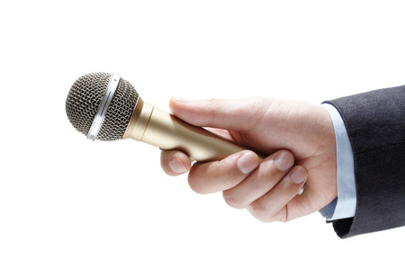 comments: hand holding out a microphone isolated on white background