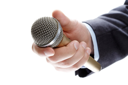 talk show: hand holding out a microphone isolated on white background