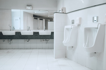 urinal: modern restroom interior with urinal row