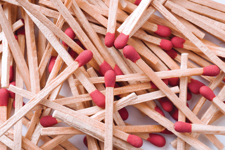 Close-up of red matches on white background.