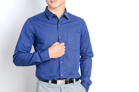 businessman in blue shirt close-up, white background.