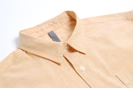 yellow plain cotton shirt White background. Stock Photo
