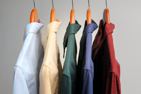 dry suit: background of shirts hanging on a hanger.