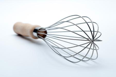 Balloon Whisk Manual Hand Egg Beater on white background.
