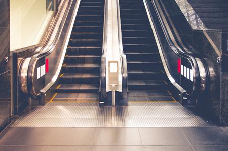 public building: Empty escalator stairs in the public building.