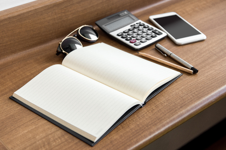 appointment book: The notebook is spread out on a wooden desk Stock Photo