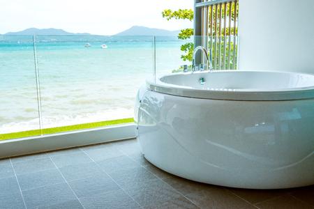 modern bathroom: Bathtub in the bathroom with sea view.