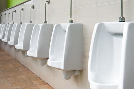 White urinal in mens bathroom Stock Photo