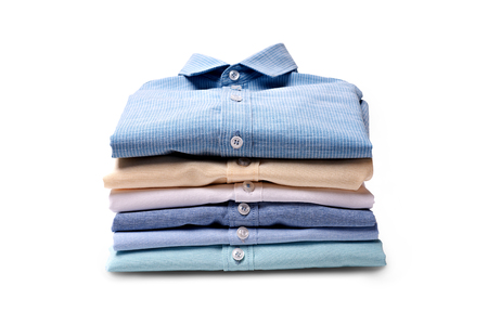 Classic men's shirts stacked on white background Foto de archivo