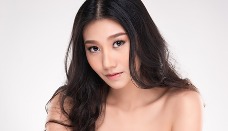 Beautiful Young Asian Woman with Clean Fresh Skin look away, Girl beauty face care. Facial treatment, Cosmetology, beauty and spa. Stock Photo