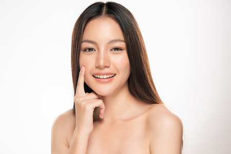 Beautiful Young asian Woman with Clean Fresh Skin look. Girl beauty face care. Facial treatment. Cosmetology, beauty and spa. Фото со стока