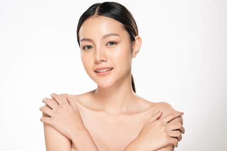 Beautiful Young asian Woman with Clean Fresh Skin look. Girl beauty face care. Facial treatment. Cosmetology, beauty and spa. Banque d'images
