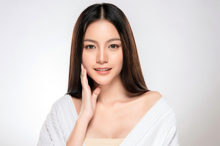 Beautiful Young asian Woman with Clean Fresh Skin look. Girl beauty face care. Facial treatment. Cosmetology, beauty and spa. Standard-Bild