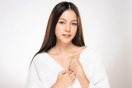 Beautiful Young asian Woman with Clean Fresh Skin look. Girl beauty face care. Facial treatment. Cosmetology, beauty and spa. Stock Photo