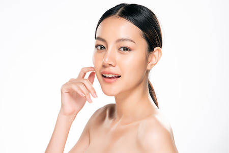 Beautiful Young asian Woman with Clean Fresh Skin look. Girl beauty face care. Facial treatment. Cosmetology, beauty and spa. Imagens