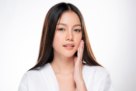 Beautiful Young asian Woman with Clean Fresh Skin look. Girl beauty face care. Facial treatment. Cosmetology, beauty and spa. Archivio Fotografico