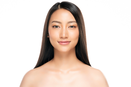 Beautiful Young asian Woman with Clean Fresh Skin look. Girl beauty face care. Facial treatment. Cosmetology, beauty and spa. 스톡 콘텐츠