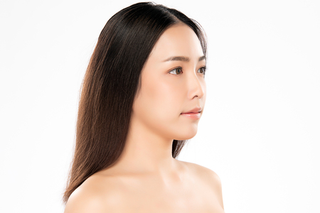 Beautiful Young Woman with Clean Fresh Skin. Face care . Facial treatment . Cosmetology , beauty and spa. Asian women portrait Stock Photo