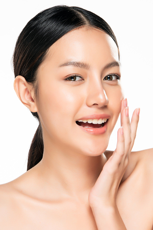 Beautiful Young asian Woman with Clean Fresh Skin look. Beautiful face and skin. Facial treatment. Cosmetology, beauty and spa. Banque d'images - 123986078