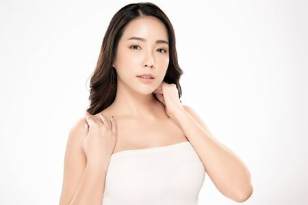 Beautiful Young Asian Woman with Clean Fresh Skin. Face care, Facial treatment, Cosmetology, beauty and spa, Reklamní fotografie