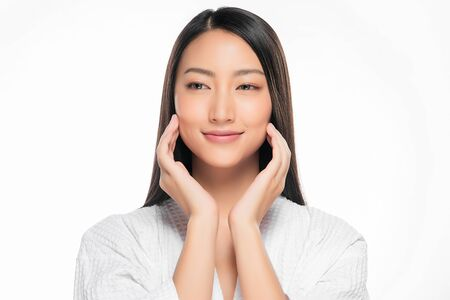 Beautiful Young Asian Woman with Clean Fresh Skin touch own face