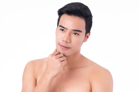 Portrait of Handsome young asian man isolated on white background. Concept of men's health and beauty, self-care, body and skin care. 스톡 콘텐츠