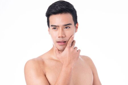 Portrait of Handsome young asian man isolated on white background. Concept of men's health and beauty, self-care, body and skin care. After exercise and sweating.