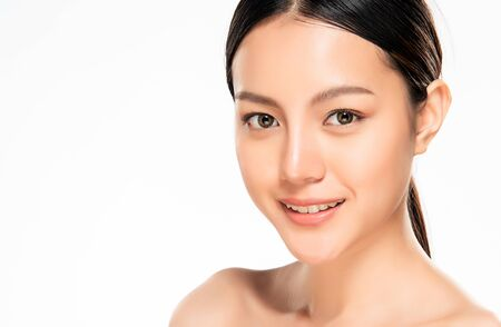 Beautiful Young Asian Woman with Clean Fresh Skin. Face care, Facial treatment, Cosmetology, beauty and healthy skin and cosmetic concept, woman beauty skin isolated on white background. Stock fotó