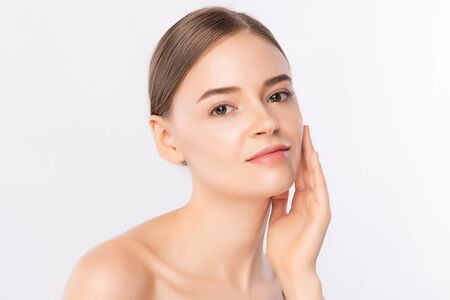 Beautiful Young Woman touching her clean face with fresh Healthy Skin, isolated on white background, Beauty Cosmetics and Facial treatment Concept.