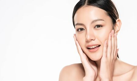 Beautiful Young asian Woman touching her clean face with fresh Healthy Skin, isolated on white background, Beauty Cosmetics and Facial treatment Concept. Stockfoto