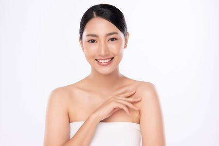 Beautiful Young Asian Woman touching her body with fresh Healthy Skin, isolated on white background, Beauty Cosmetics and Facial treatment Concept