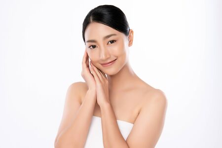 Beautiful Young asian Woman touching her clean face with fresh Healthy Skin, isolated on white background, Beauty Cosmetics and Facial treatment Concept, Standard-Bild