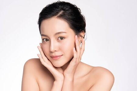 Beautiful Young asian Woman touching her clean face with fresh Healthy Skin, isolated on white background, Beauty Cosmetics and Facial treatment Concept, Stock fotó