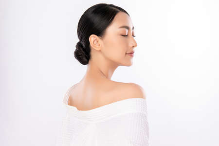 Side view of Beauty Woman face Portrait, Beautiful Young Asian Woman with Clean Fresh Healthy Skin, Facial treatment. Cosmetology, beauty and spa, isolated on white background. Foto de archivo