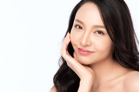 Beautiful Young asian Woman with Clean Fresh Skin, on white background, Face care, Facial treatment. Cosmetology, beauty and spa. Asian women portrait Stock Photo