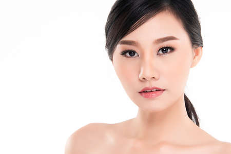 Beautiful Young asian Woman with Clean Fresh Skin, on white background, Face care, Facial treatment, Cosmetology, beauty and spa, Asian women portrait Imagens