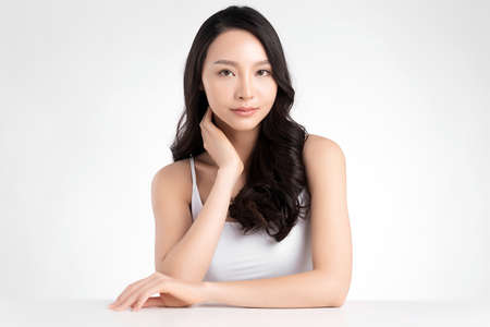 Beautiful Young asian Woman with Clean Fresh Skin, on white background, Face care, Facial treatment. Cosmetology, beauty and spa. Asian women portrait Stockfoto
