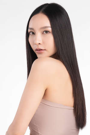 Beautiful young asian woman with clean fresh skin on white background, Face care, Facial treatment, Cosmetology, beauty and spa, Asian women portrait Foto de archivo - 155352850