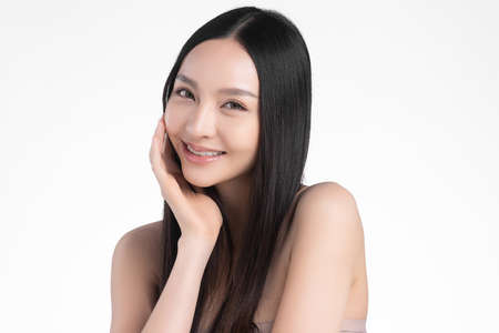 Beautiful young asian woman with clean fresh skin on white background, Face care, Facial treatment, Cosmetology, beauty and spa, Asian women portrait Foto de archivo - 155352684