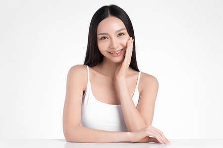Beautiful young asian woman with clean fresh skin on white background, Face care, Facial treatment, Cosmetology, beauty and spa, Asian women portrait Foto de archivo - 155353070