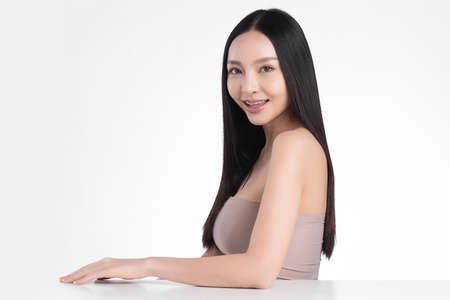 Beautiful young asian woman with clean fresh skin on white background, Face care, Facial treatment, Cosmetology, beauty and spa, Asian women portrait Foto de archivo - 155352900