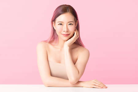 Beautiful young asian woman with clean fresh skin on pink background, Face care, Facial treatment, Cosmetology, beauty and spa, Asian women portrait