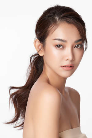 Beautiful young asian woman with clean fresh skin on white Stock fotó
