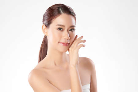 Beautiful young asian woman with clean fresh skin on white background, Face care, Facial treatment, Cosmetology, beauty and spa, Asian women portrait 版權商用圖片