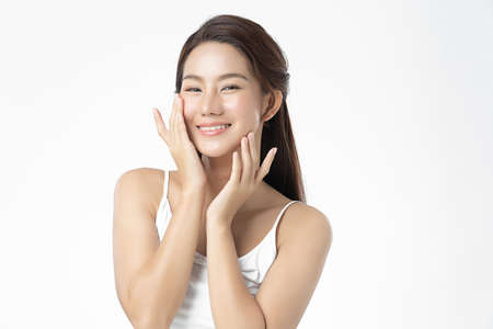 Beautiful young asian woman with clean fresh skin on white background, Face care, Facial treatment, Cosmetology, beauty and spa, Asian women portrait. 版權商用圖片